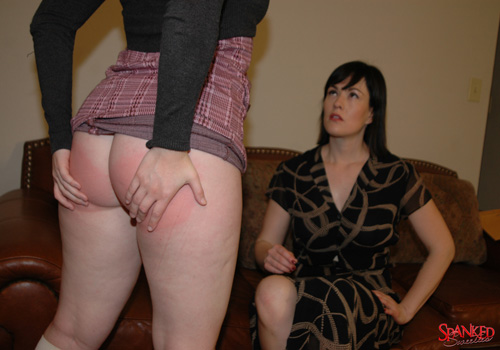 We admire Sophia's well-spanked bottom as she stands up from her OTK spanking