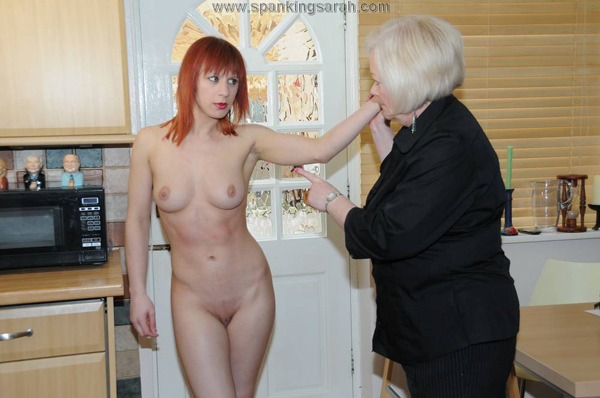 Darcy Grey strips naked for a body search and spanking from Katie