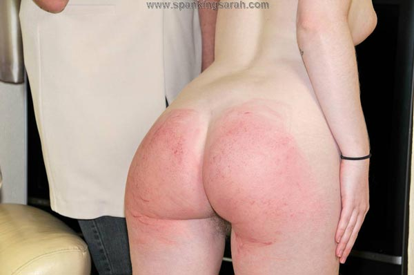 Satine's blonde pubic hair is visible through her spanked bare bottom cheeks