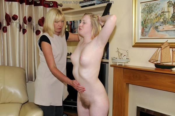 Satine Spark shows off her bushy hairy pussy after her paddling