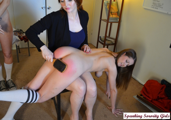 Veronica uses the wooden hairbrush on the two naughty bare bottoms