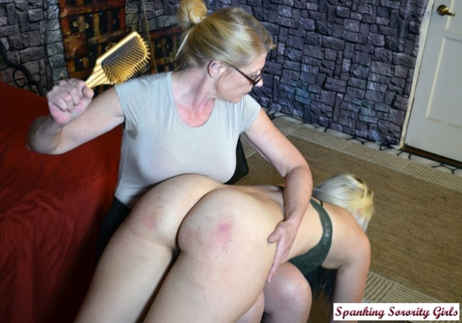 Miss Cassie spanks Dria OTK with a wooden hairbrush