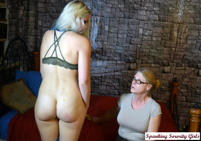 Miss Cassie inspects Dria's spanked and paddled bare bottom