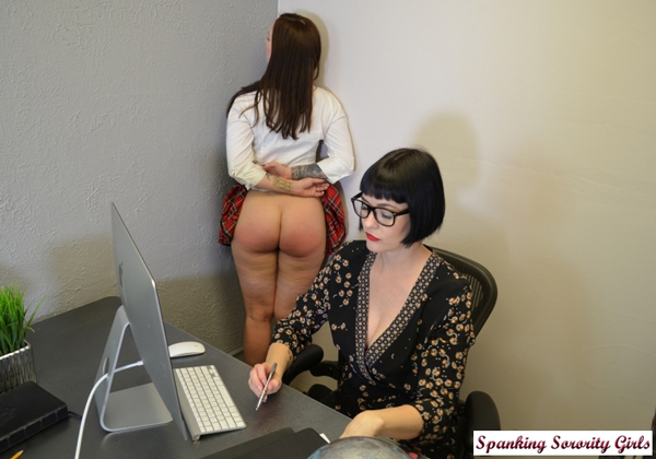 Snow gets back to work in her strict-looking glasses while Amelie does some corner time