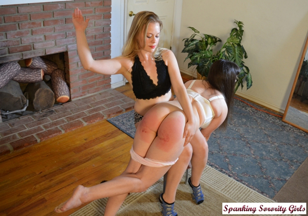Stevie Rose spanks Elori's bare bottom hard with her hand