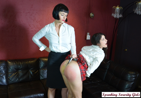 Teacher Snow Mercy gives Arielle Lane a wedgie while she spanks her in her school uniform