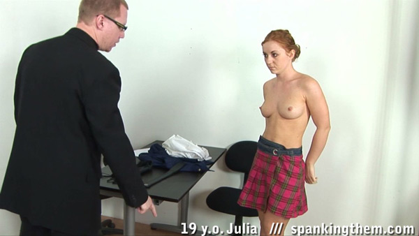 19-year-old Julia gets topless for her punishment at Spanking Them
