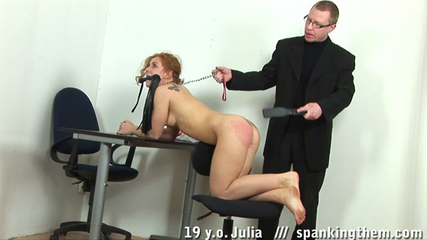 Julia gets humiliated by wearing a leash and holding the whip in her mouth while she's punished