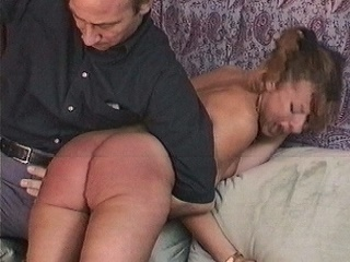 Uncle Steve lays into Sharon's pretty bottom with the palm of his hand