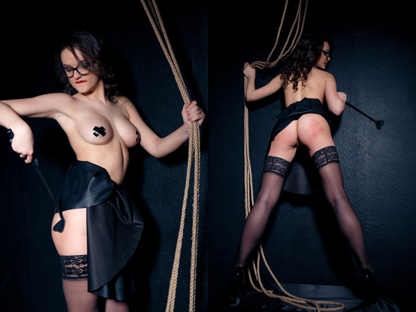 Maria Z spanks herself with the riding crop in stockings with black crosses over her nipples