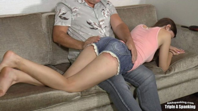 Skylar Rose's pert bottom is spanked OTK over her tight denim shorts