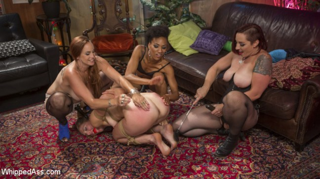 Mistress Kara, Bella Rossi and Nikki Darling spank and slap Mona with a riding crop