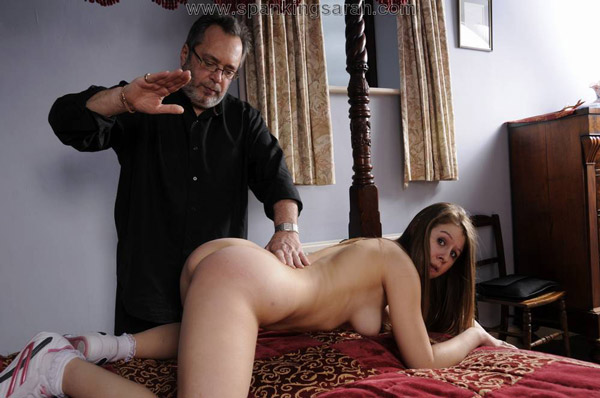 Naughty Masie Dee getting spanked on the bed