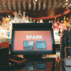 spark epos system in front of qr scanner and PDQs in a restaurant