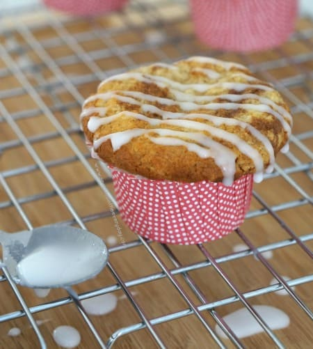 Gluten Free Cinnamon and Honey Swirl Muffins topped with icing!