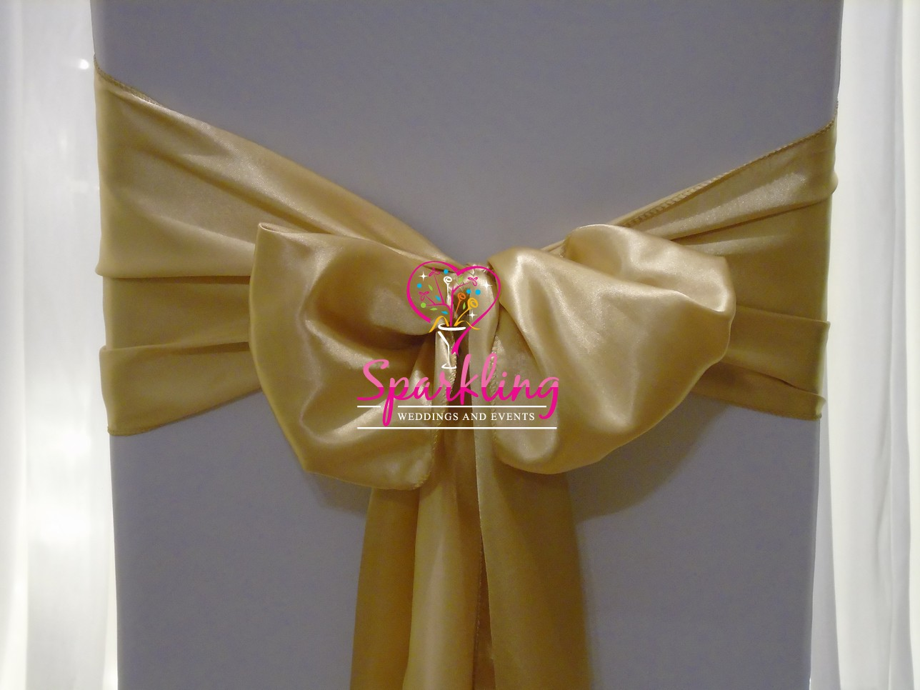 gold chair covers with black sash stylist mats and bows