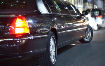 Low angle view of black limousine in city at night