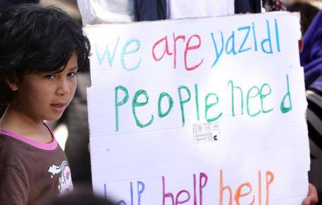 """We are Yazidi people, Need Help Help Help"" (ANS/AFP/FILIPPO MONTEFORTE/POOL)"
