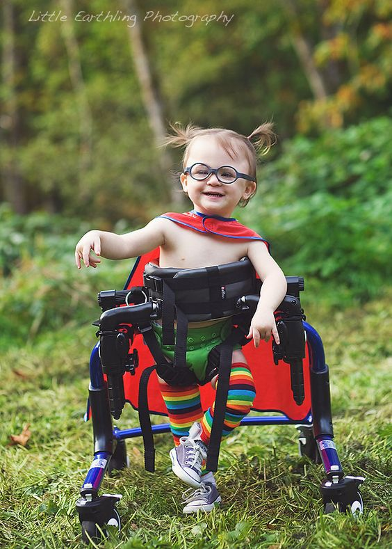 Learn how to take beautiful photographs of children with special needs. Inspirational children with special needs photographed as superheroes!