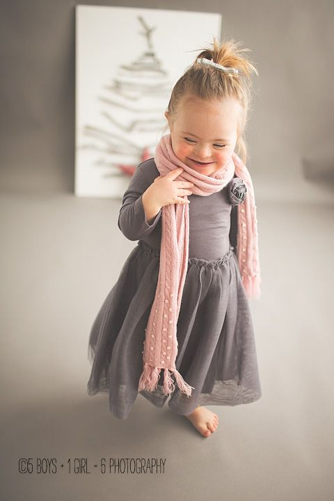 Beautiful little girl with Down Syndrome. Learn to take beautiful photographs of children with special needs.