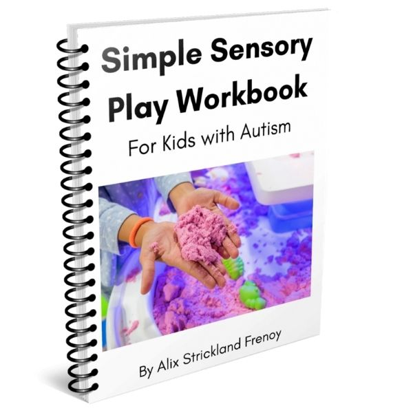 autism workbooks - a child's hands playing with purple kinetic sand