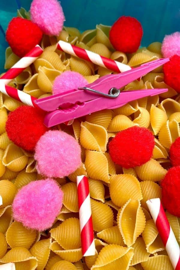 close up of a Valentine's Day sensory bin