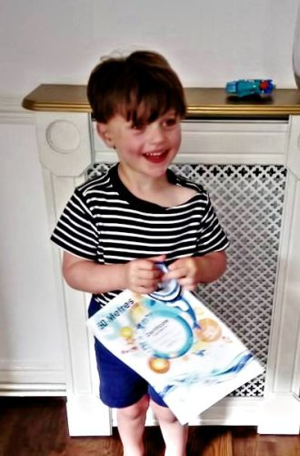 Picture of Phillipa's son with his certificate