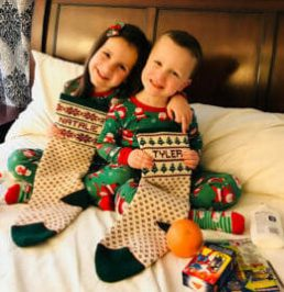 Kids with Christmas stockings from Specialties in Wool