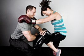 Kickboxing Instructor man and woman sparring