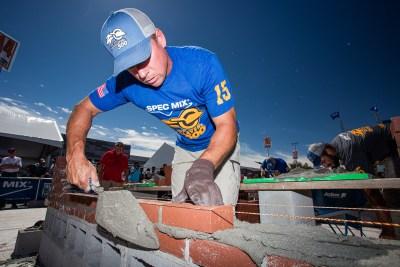 Brian Wade scraping SPEC MIX mortar off the wall