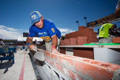 Mario Landeros focused on mortar and brick