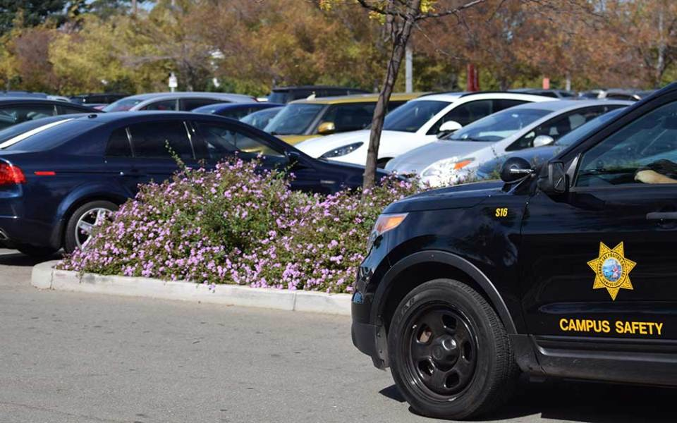 A campus safety car drives through Chabot College's parking lot B.