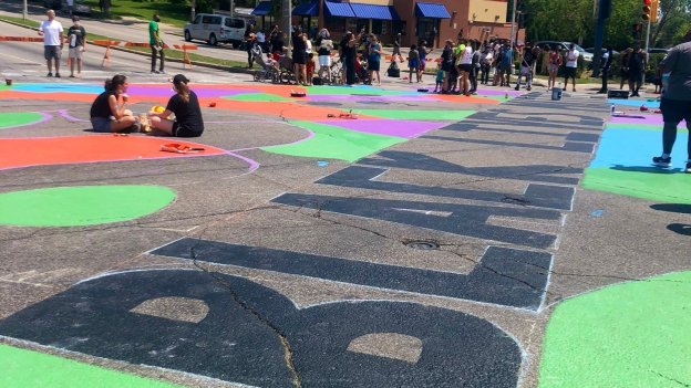 Black Lives Matter is painted in giant letters on the street