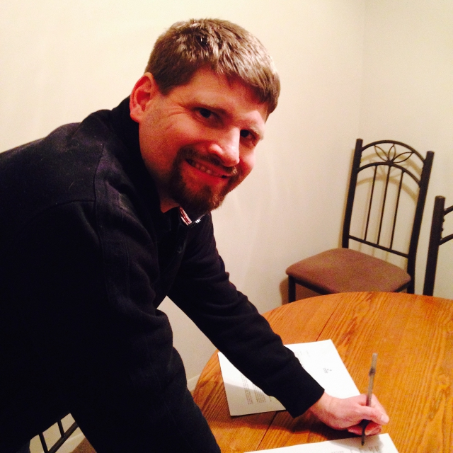 Picture of book deal signing.