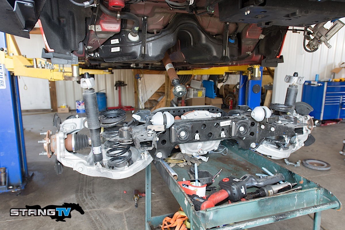 hight resolution of to get things going we need to drop the entire rear subframe out of the car the forward differential bolts cannot be removed with the subframe in the car