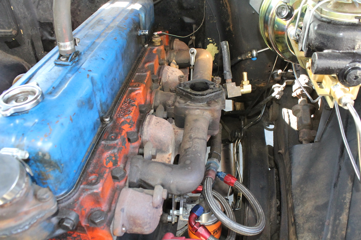hight resolution of removing the oil bath air cleaner and single barrel carb exposed the small intake manifold passage