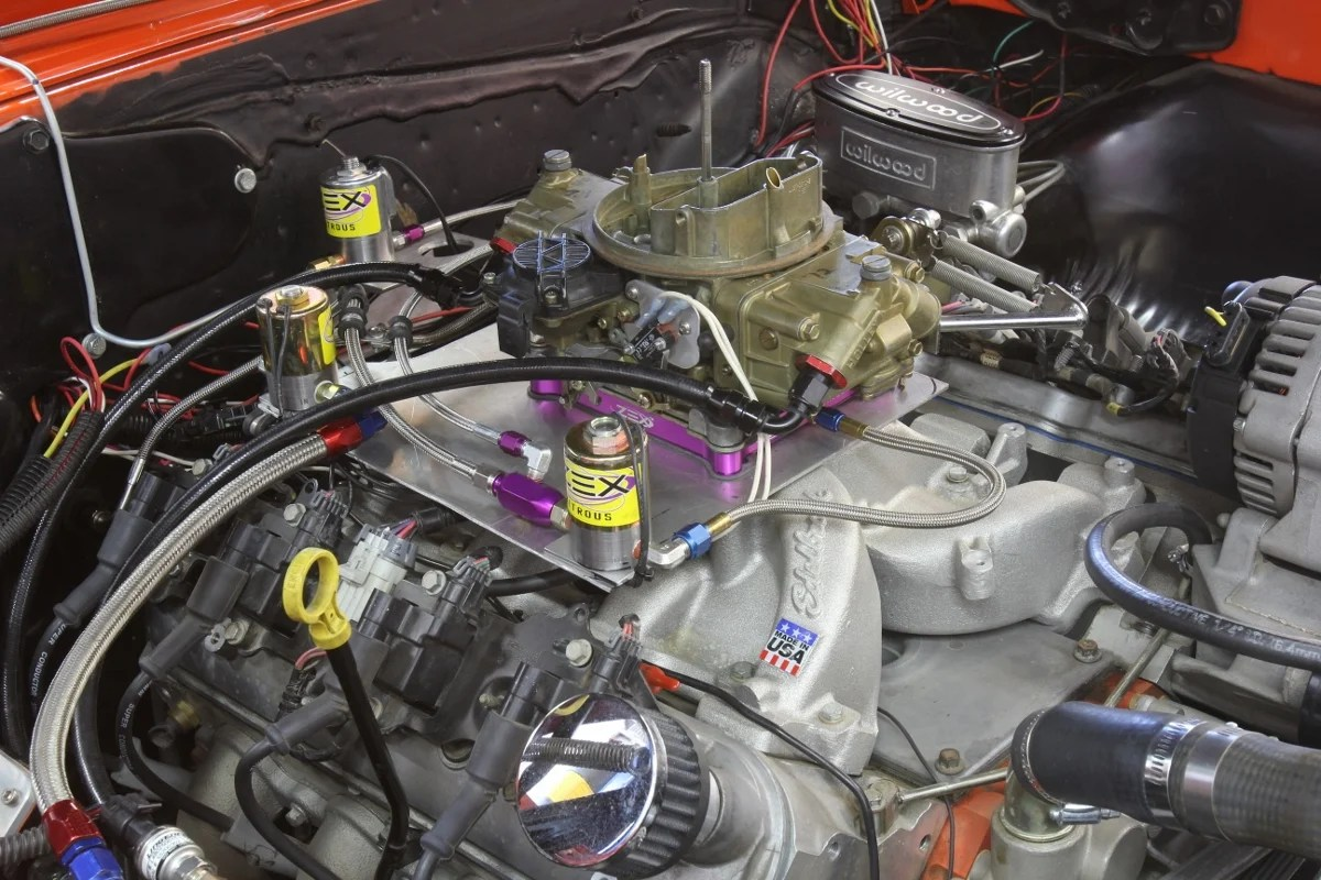hight resolution of converting an ls engine to a carburetor is actually pretty easy unbolt the factory intake bolt on an intake like this edelbrock performer rpm and a holley