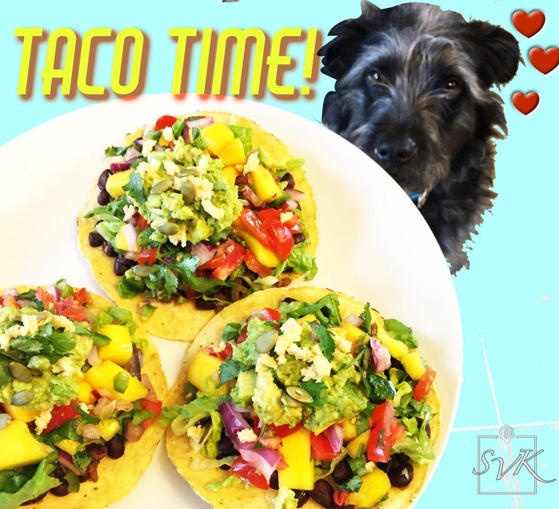 Making doggy eyes at tacos