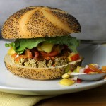 Black bean sweet potato burger with spicy mango salsa. Vegan and gluten-free.