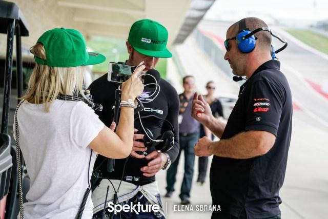 Earchphoto - Brooke De Boer filmind Derek as he talks with a team member.