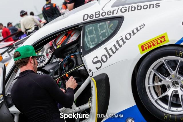 Earchphoto - Derek assisting Sean on pre-grid at COTA.