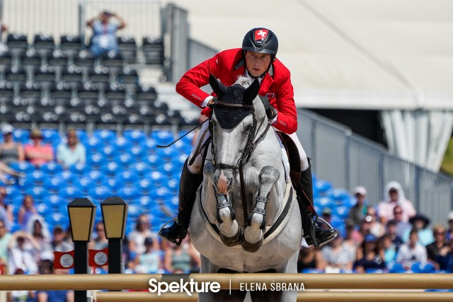 Earchphoto - Martin Fuchs and Clooney at the 2018 World Equestrian Games in Tryon NC