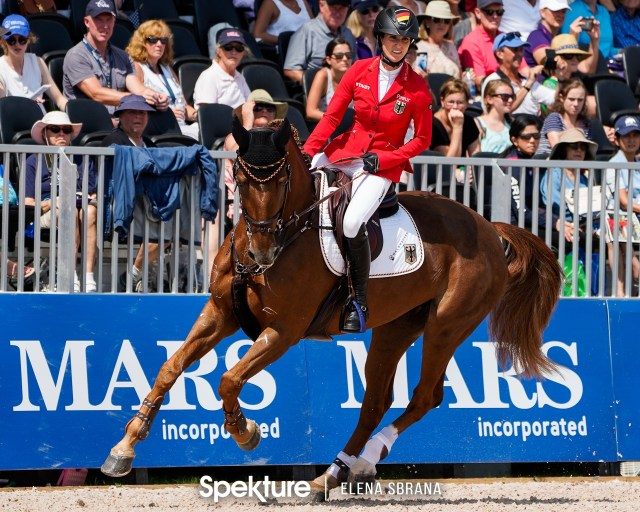Earchphoto - Simone Blum enters the arena at the 2018 World Equestrian Games in Tryon NC