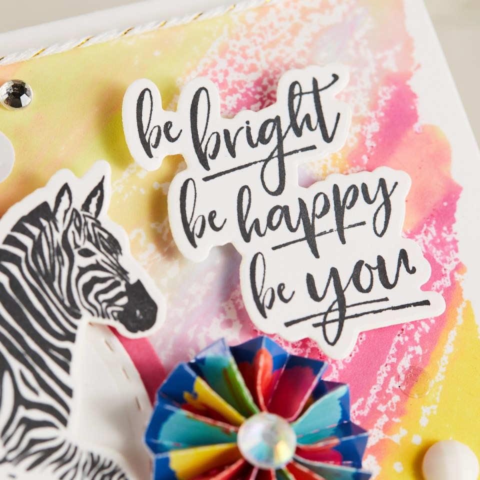 closeup of zebra card that says Be Bright, Be Happy, Be You, by Mariana Grigsby with watercolor background and rubber stamped zebra