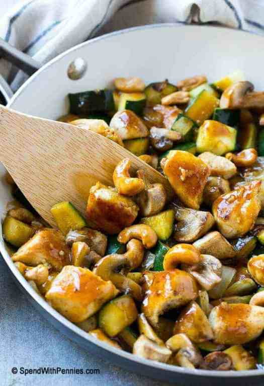 Chicken Stir Fry with cashews and zucchini in a pan
