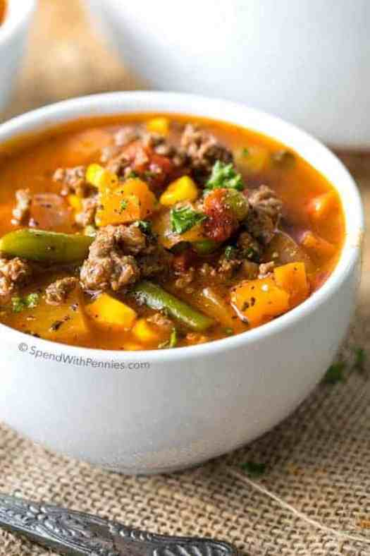 Easy Hamburger Soup with assorted vegetables in white single serving bowl