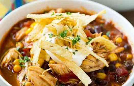 Crockpot Chicken Enchilada Soup in large white bowl