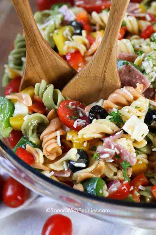 A bowl full of colorful Italian Pasta salad ready for a party!