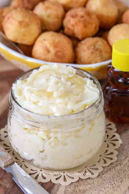 A jar of honey butter next to our favorite hushpuppies