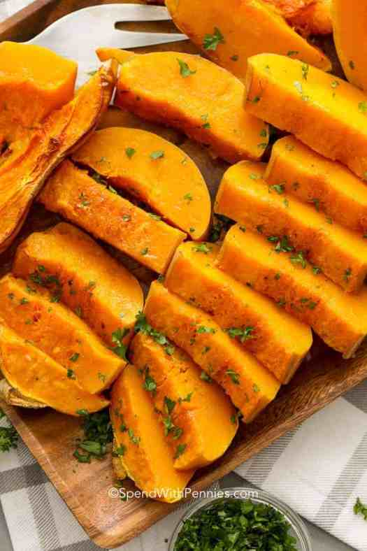 Baked Butternut squash on a wood plate ready to serve